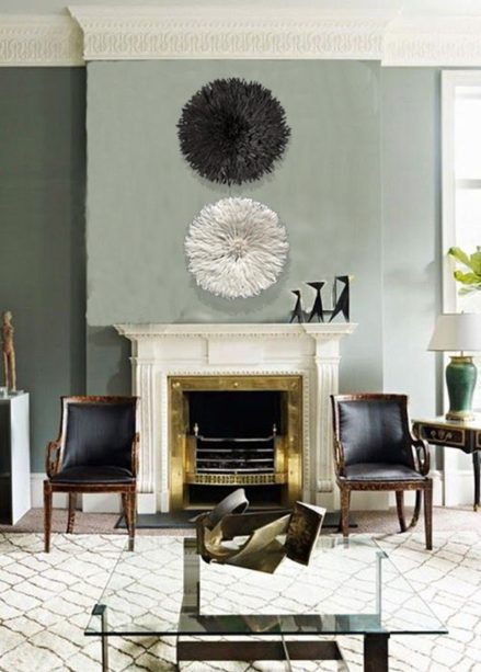 Set of black and white juju hat above the fireplace