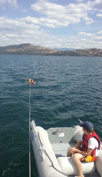 Part of the fun of sailing on Flathead Lake with kids is being pulled along on the rope behind the boat.