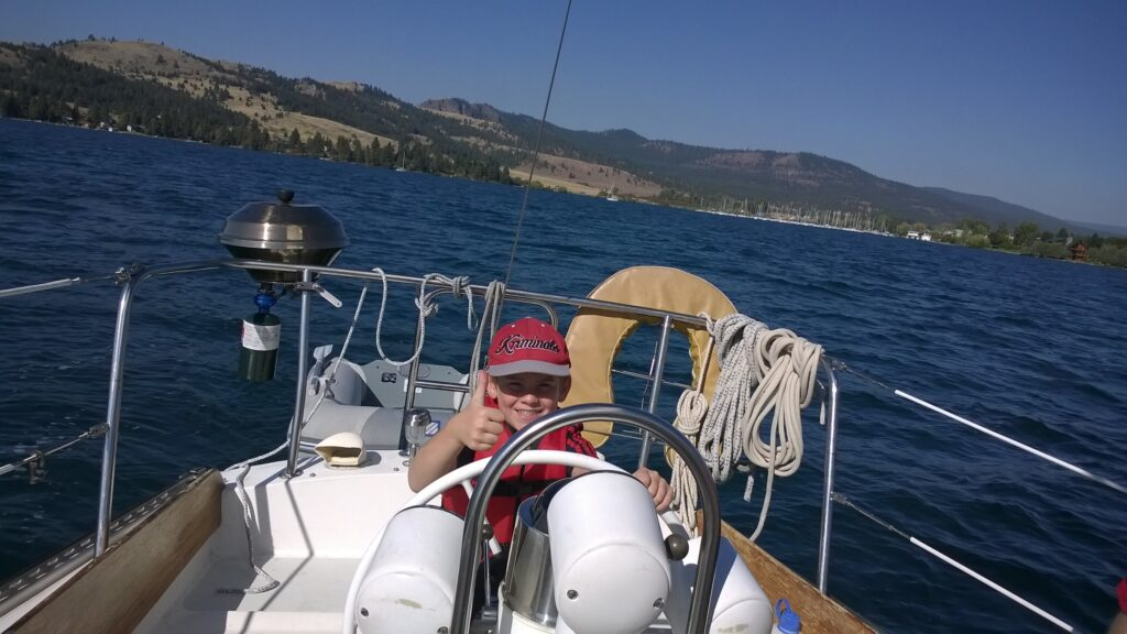 Getting to pilot the sailboat is an experience every kid will remember forever.