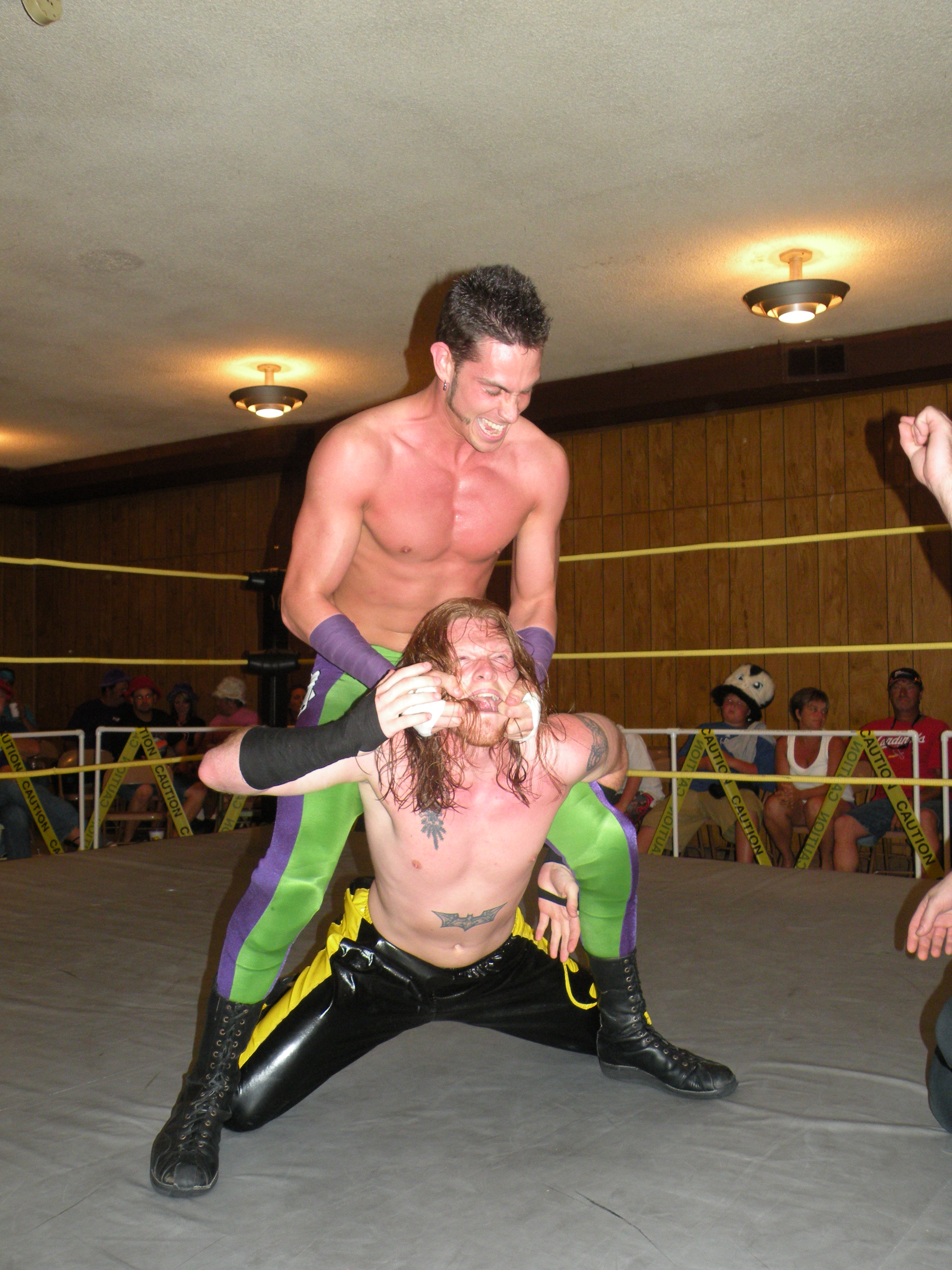 "Slade is ruthless in his attack against the Champion. (Photo credit Brian ""Flair"" Kelley)"