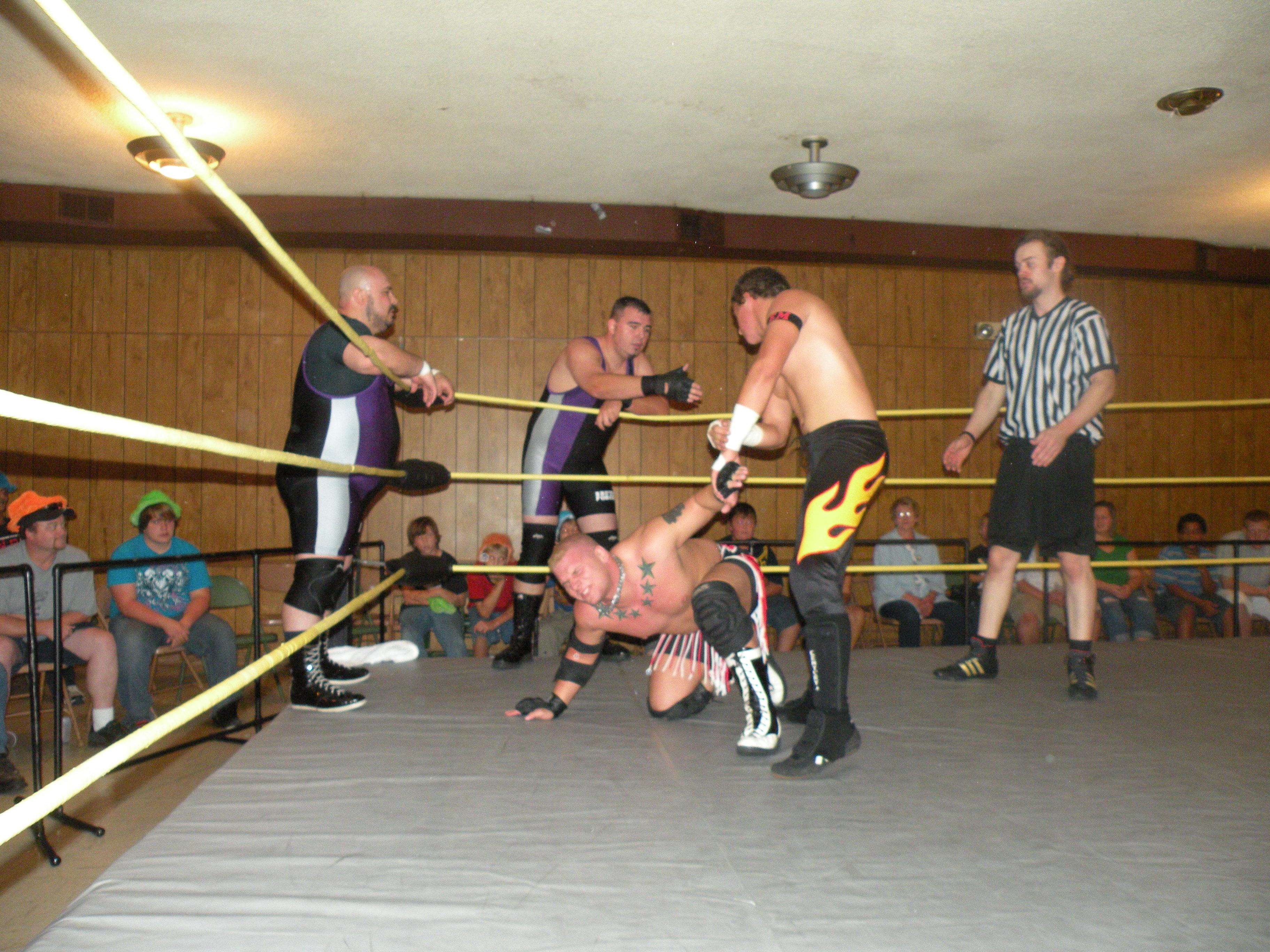 "Evan Money keeps Bailey Mannix in the corner.(Photo Credit Brian ""Flair"" Kelley)"