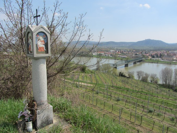 Piety column with a view to the city of Martern and the bridge across the Danube. Monastery Göttweig in the background