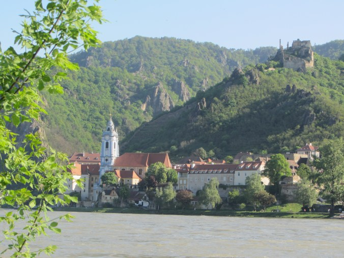 Medieval town of Dürnstein with the blue church tower and the ruin where ,in the year 1192, Richard Lionheart was imprisoned by the Austrian Duke Albrecht V