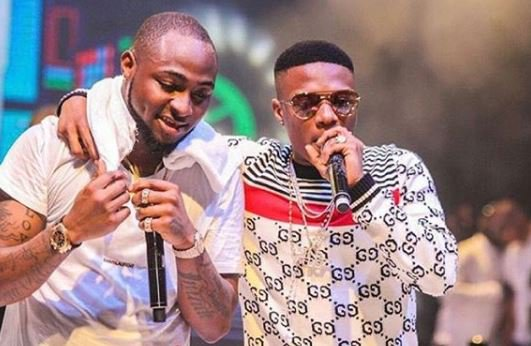 Wizkid intervenes after his fan trolled Davido