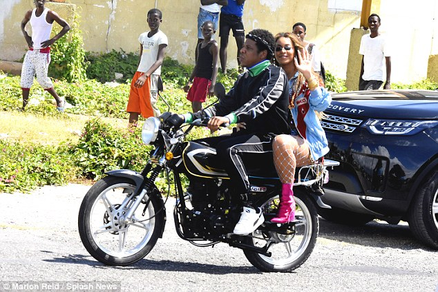 Beyonce and Jay-Z ride a bike in Jamaica