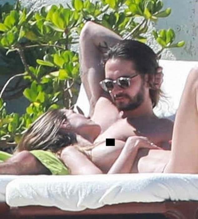 Heidi Klum goes topless while on vacation with younger boo
