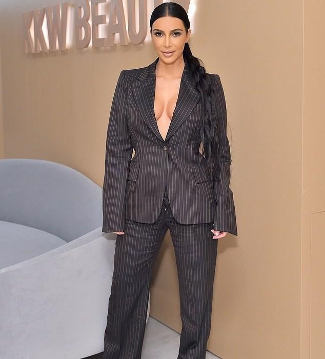 Kim Kardashian goes braless in classy pinstripe suit