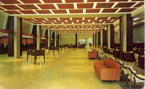 FIRST NATIONAL BANK, JACKSON, MISSISSIPPI. The main lobby of First National Bank features thirty-two teller windows, a customer lounge, three conference rooms plus the officers' area. Unusual lighting, colors and materials combine to create s triking, decorative effect.