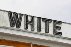 """WHITE"" channel-set neon letters, White Pillars Restaurant, Biloxi MS Nov. 2012"