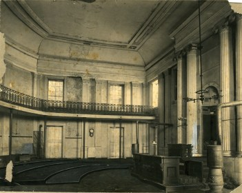 J. F. Laist, 1915. House of Representatives. Interior of Old Capitol Building, photo shows dilapidated condition, pieces of broken plaster and rubble on floor, Corinthian columns, railings, balcony. MDAH Accession PI/STR/C36 /Box 20 Folder 95