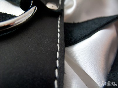 Fine white stitching throughout