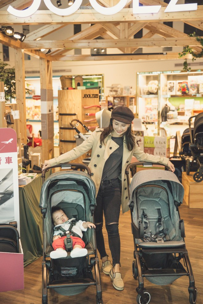 A person pushing a stroller  Description automatically generated with medium confidence