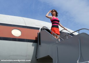 Vintage dress, vintage plane; both are a bit cramped for space...