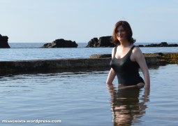 This pool was ancient, decrepit, manky, and full of sea critters. The smile is fake.