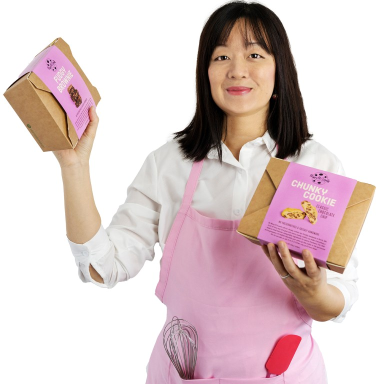 maryann holding up a fudgy brownie box and chunky cookie box