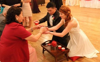 Bride and groom serving tea to groom's grandparents