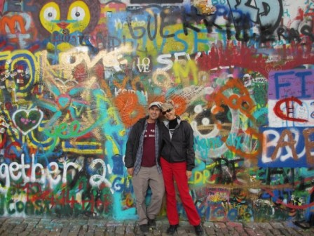 Vinnie and husband in front of Lennon Wall