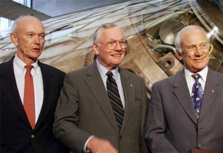 **ADVANCE FOR MONDAY, JULY 20** FILE - In this July 20, 1999 file photo, Apollo 11 astronauts Michael Collins, left, Neil Armstrong, center, and astronauts Buzz Aldrin, are awarded the Samuel P. Langley medal, at a ceremony at the Smithsonian's Air and Space Museum in Washington. (AP Photo/Doug Mills, file)