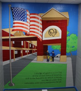 Mural depicting Heritage Elementary School with American flag in foreground