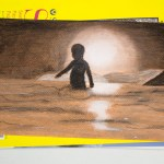 Silhouette drawing of a boy wading in the beach at sunset, in charcoals on orange paper