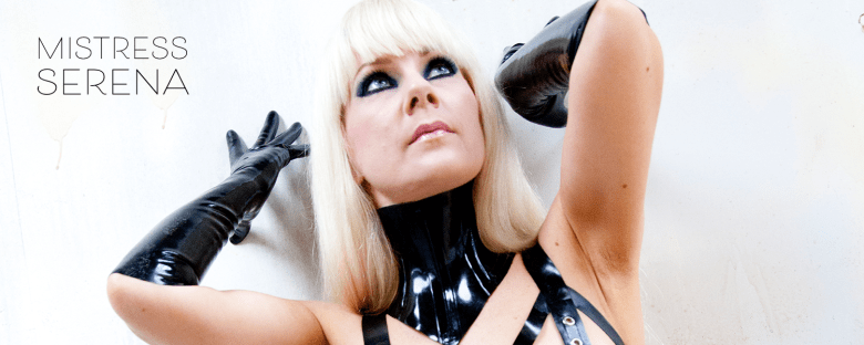 blonde glamourous mistress close up pic with heavy makeup and blonde hair and latex gloves