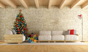 Christmas living room with pallet sofa, stone wall and wooden beams