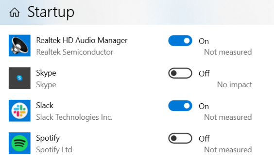 Startup Apps system setting, showing Realtek HD Audio Manager set to on, Skype set to off, Slack set to on, Spotify set to off