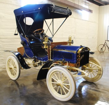 """The 1904 Mitchell Runabout is a small, light vehicle that was considered a """"ladies"""" car when it came out, as it didn't require a lot of power to crank the motor or push the car while in neutral. This 1904 is shown with the optional top cover."""