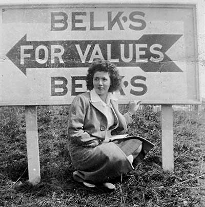 Doris Thompson in front of the Belk sign on Lower Street
