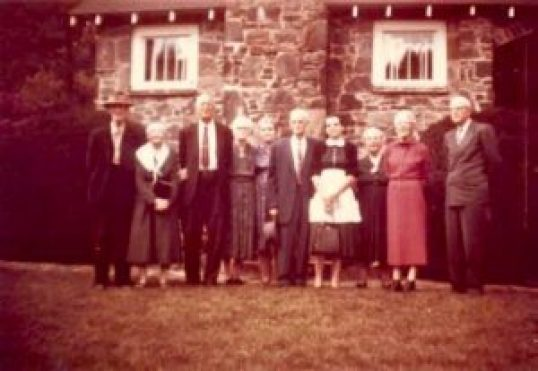 """This photo was made the Summer of 1960 at the home of Rom and Connie Duncan. The house was located on Hwy 19E where the """" 50's Diner"""" is now located. Shown at the First Duncan Reunion are the sons and daughter of Washington (Wash) Duncan and Martha Pendley Duncan. Not pictured are daughters Ora Duncan Freeman and Sadie Duncan Grindstaff. Left to right- James L. Duncan and wife Maggie Serepta Pendley Duncan; Milton Swan, wife Docia Duncan Swan; Ruth Putnam Duncan wife of Robert Duncan deceased; Dallas Duncan and wife Edna Duncan; Susie Rose wife of Isaac Duncan (Ike) deceased, Connie Jolley Duncan and husband Rom Duncan. Photo courtesy of Nelle Glenn."""