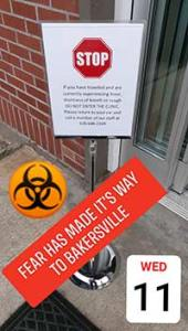 Photo of the entrance to the Bakersville Clinic with a warning up about COVID-19