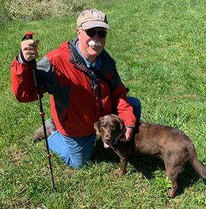 Bill Sweetser poses with his dog Scout