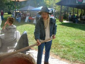 Photo of Germaine Galjour Stirring Apple Butter