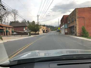 Photo looking down the main portion of Upper Street in Spruce Pine with no traffic