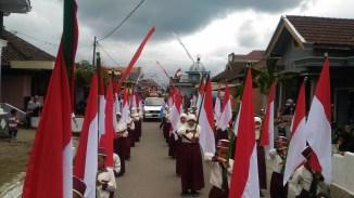 Pasukan Bendera MI Thoriqotussa'adah dalam acara HUT Desa Ngabab Kecamatan Pujon Kab Malang yang ke 174