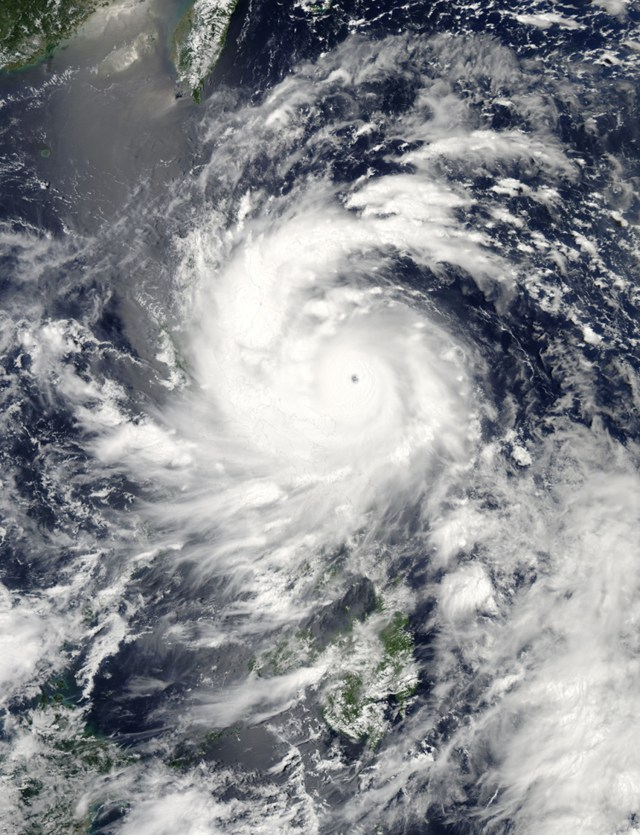 Visible light satellite image of 12 August 2013 as a strong category 3 Typhoon UTOR approached landfall in the Philippines