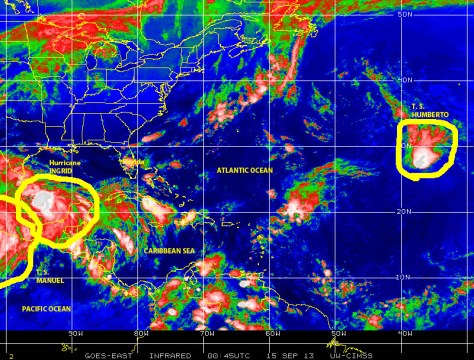 Color-enhanced infrared satellite image from late on 14 September showing three active named tropical cyclones; Hurricane INGRID and Tropical Storm Humberto in the Atlantic Basin and Tropical Storm Manuel over the Eastern PAcific basin