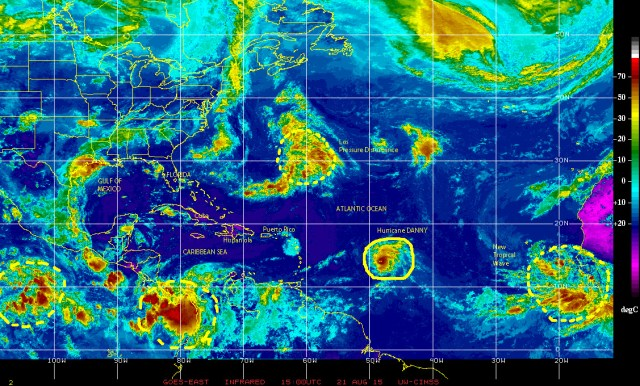 Color-enhanced infrared satellite image [NOAA] of 08/21/2015 showing a now Category 2 Hurricane DANNY, the low pressure disturbance being investigated by the NHC near Bermuda, and a new tropical wave just emerging over the eastern Atlantic south of the Cape Verde Islands and also being investigated by the NHC!