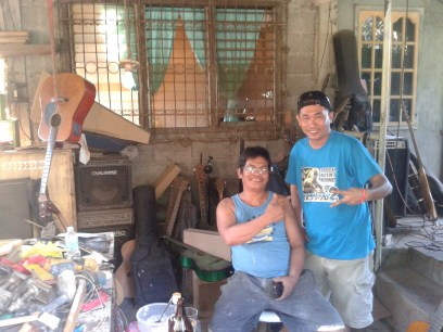 Master Builder and Luthier, Sir Edgar R. Rabago (seated) with Danzoy of Mitochondria at the ER Custom Shop