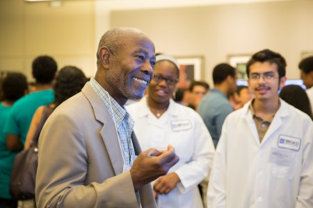 MITES Faculty Director Dr. Cardinal Warde engages with Genomics program students.