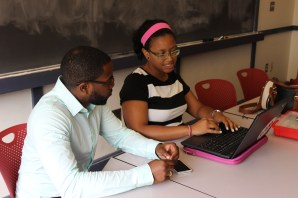STEM Program Instructor Liliana Almonte (right) discusses her proposed biology curriculum with advisor Cyrus Washington. Instructors met with experienced teachers and subject matter experts to fine tune their curricula. Cyrus is pursuing a graduate degree in Immunology at Harvard Medical School.