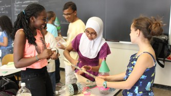 In their level two physics course, Doralee Heurtelou, Sitnour Elamin, and Evelyn Reyes build rockets out of plastic bottles and duct tape.