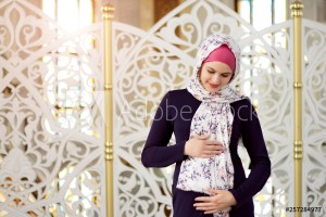pregnant woman in a hijab - Image
