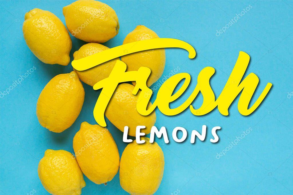 top view of ripe yellow lemons on blue background, fresh lemons illustration