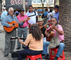 Locals enjoying music close to Plaza Botero