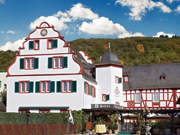 """Diana Hein und Uwe Girnstein betreiben ihr Hotel im """"Von der Leyen'schen Hof"""" aus dem späten 16. Jahrhundert. Foto: Hotel Rheingraf"""