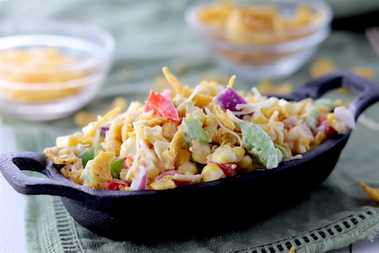 Light Potluck Corn Salad with Crushed Fritos in a Cast Iron Dish