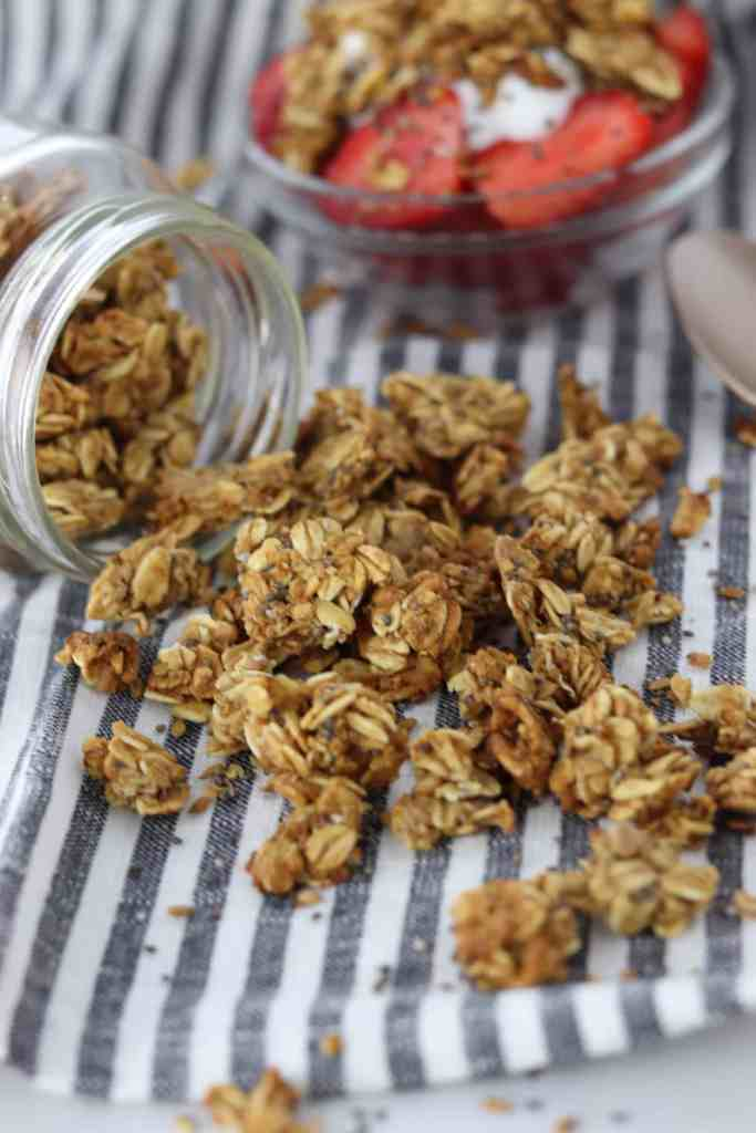 Chia & Flax Granola spilling from a jar