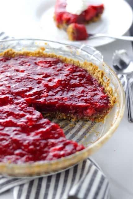 fresh strawberry pie with an oatmeal cookie crust in a pie pan