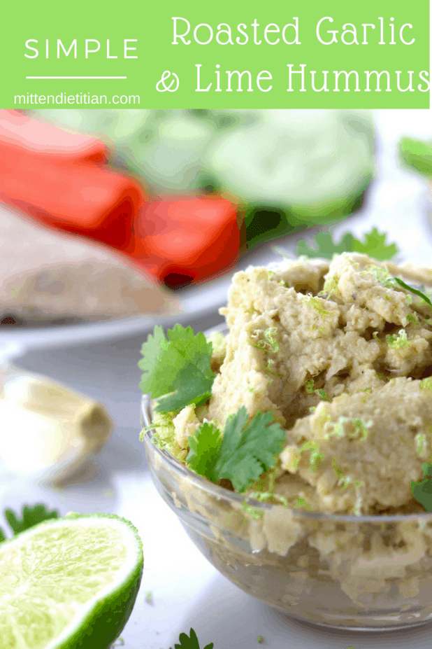 Simple roasted garlic and lime hummus in a dish with veggies